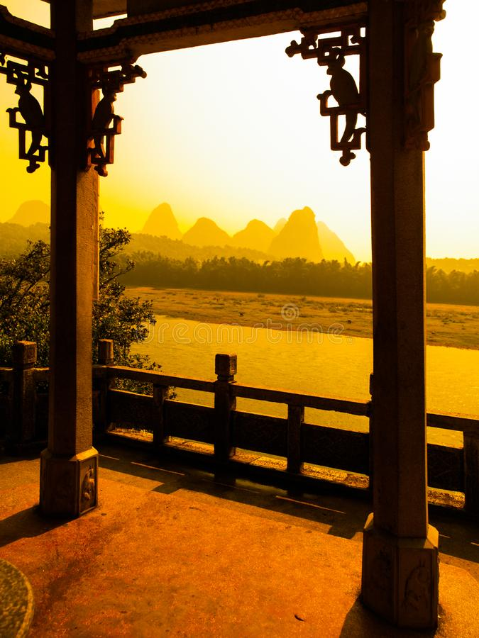 Sunset in karst landscape around Yangshuo an Li River with peaks silhouettes, Guangxi Province, China. View from terrace stock photo