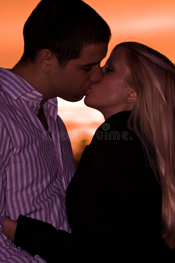 Download Sunset kiss stock photo. Image of sunset, lifestyle, female - 7024730