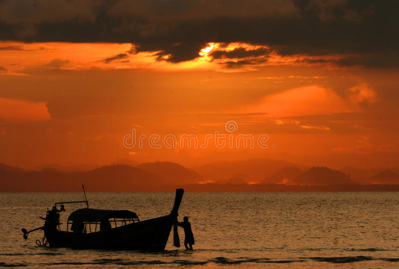 Sunset at Koh Ngai. The sunset scene with fisherman coming back from work at Koh Ngai, Trang, Thailand royalty free stock images