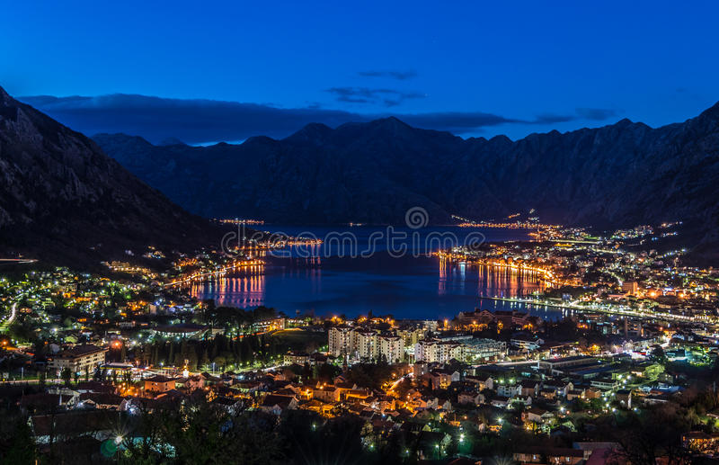 Sunset in Kotor boka bay. City lights stock images