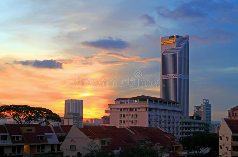 Sunset in Kuala Lumpur. Looking west from Bukit Bintang with Tong Shin hospital and the Maybank Tower Building royalty free stock images