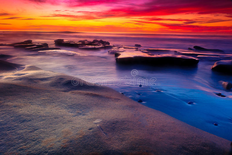 Sunset in La Jolla. A sunset scene at Wind and Sea beach in La Jolla, California during the winter of 2014 stock photography