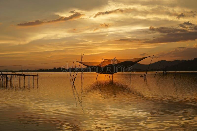 Sunset on Lak Lake, fishing equipment on the lake royalty free stock photos