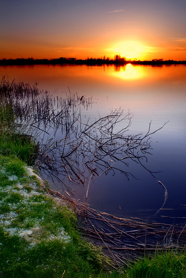Sunset by the lake stock photography