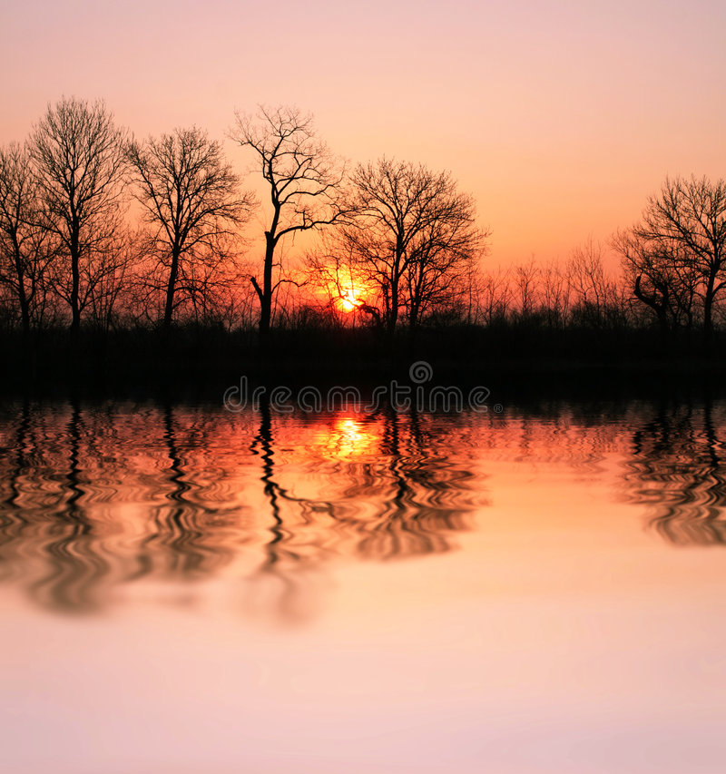Sunset on the lake royalty free stock photography