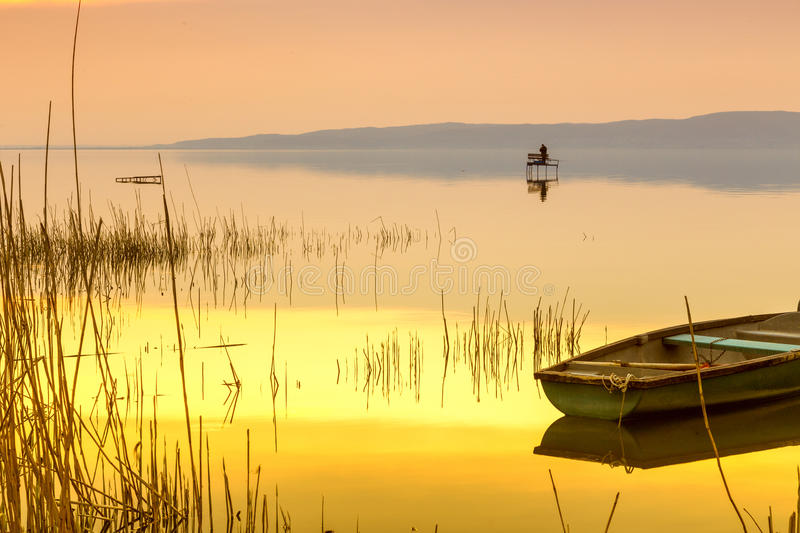 Sunset on the lake Balaton with a boat stock photo