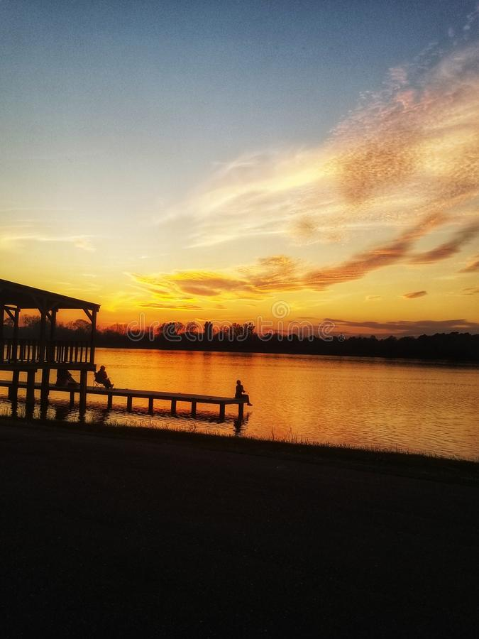 Sunset at the lake stock image