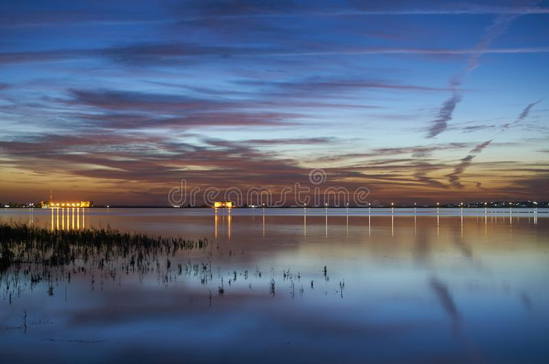 Sunset on the lake. Beautiful clouds reflected in the water. royalty free stock photos