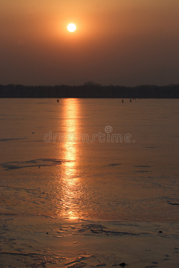 sunset on the lake in beijing summer palace royalty free stock image