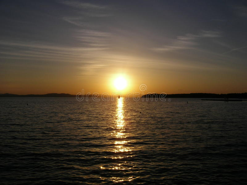 Sunset on Lake Champlain. Lake Champlain at Burlington in Vermont State. Its very nice sunset with lighthouse. Lake Champlain located mainly within the borders stock photo