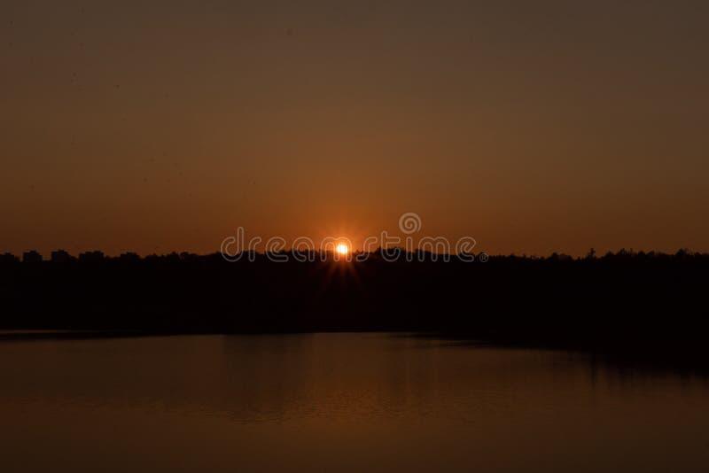 Sunset on the lake. Evening stock photos