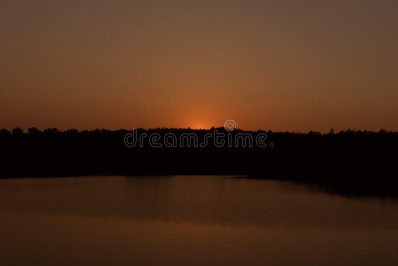 Sunset on the lake. Evening stock photo