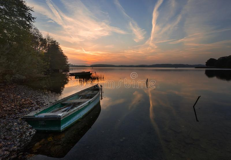 Sunset lake with fisherman boat landscape. stock photo