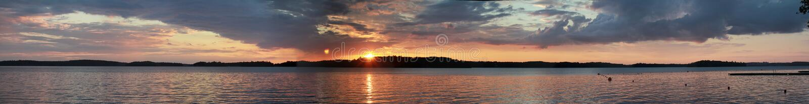 Sunset on the lake horizon landscape. Dark sunset over river water view panoramic royalty free stock photo