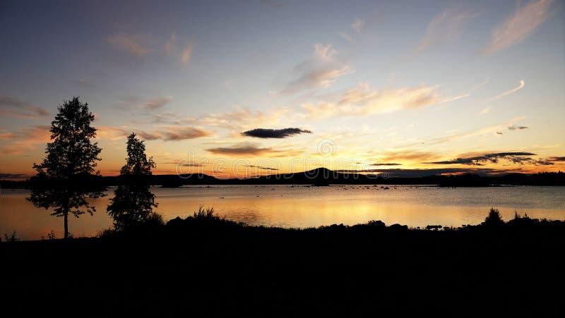 Sunset at Lake Hornavan near Arjeplog in summer in Lapland, Sweden stock photo