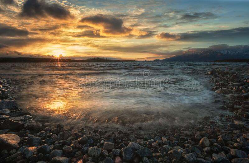 Sunset on the lake Imandra in summer. Against the backdrop of the Khibiny mountains. stock image