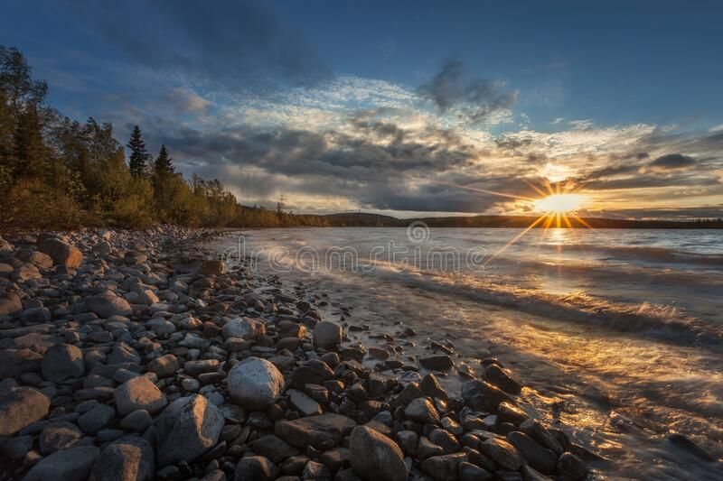 Sunset on the lake Imandra in summer. Against the backdrop of the Khibiny mountains. royalty free stock photos