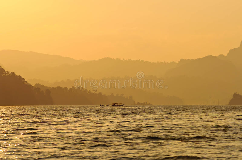 Sunset at lake,Khao Sok National Park, Mountain and Lake in Southern Thailand stock images