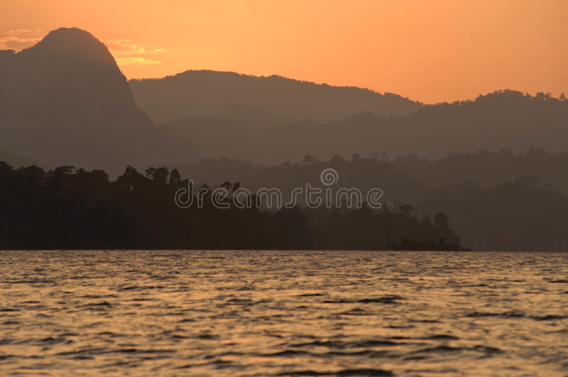 Sunset at lake,Khao Sok National Park, Mountain and Lake in Southern Thailand stock photo