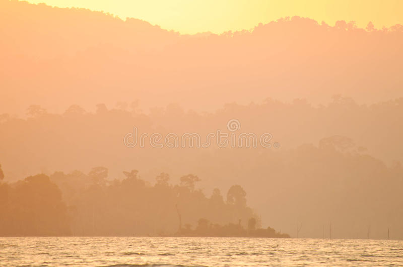 Sunset at lake,Khao Sok National Park, Mountain and Lake in Southern Thailand stock photography