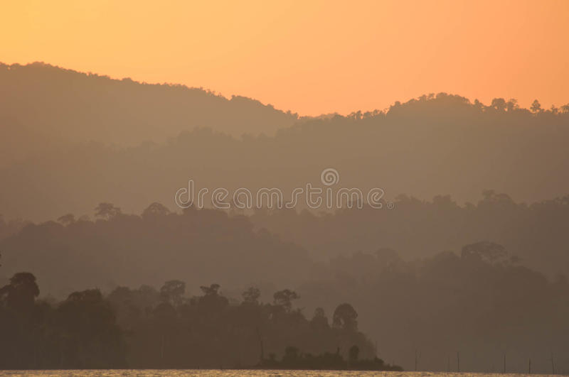 Sunset at lake,Khao Sok National Park, Mountain and Lake in Southern Thailand royalty free stock photography