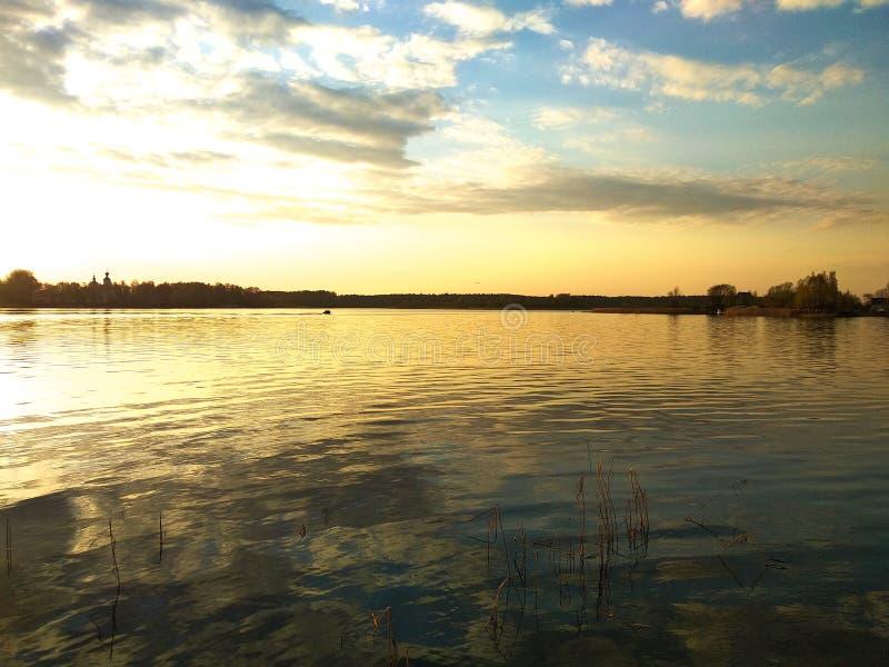 Sunset on the lake. Quiet summer evening. stock photo