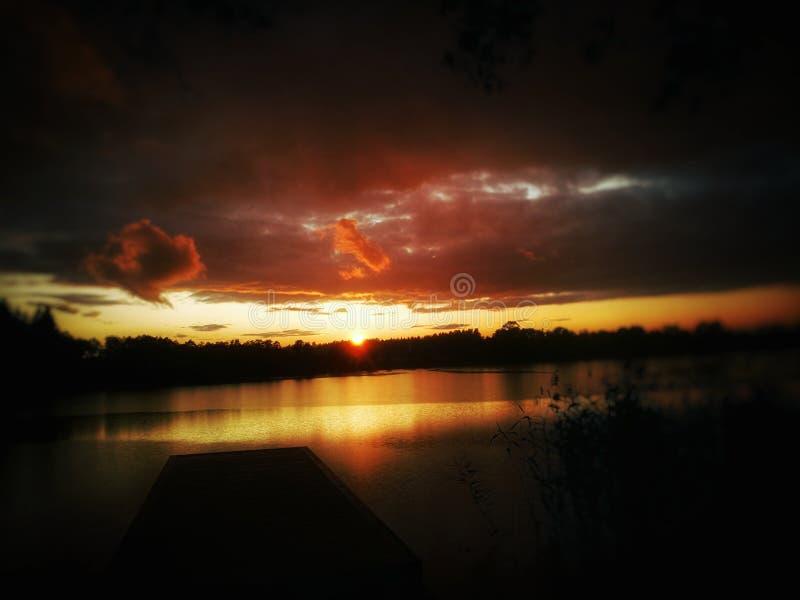 Sunset by lake royalty free stock photo