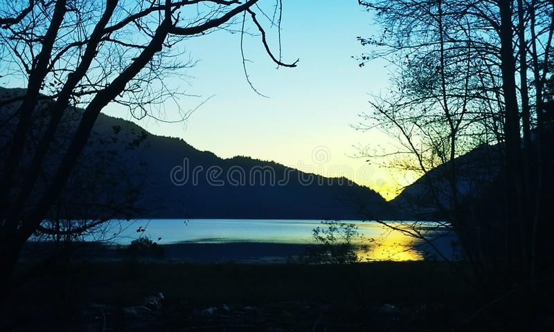 Sunset on the lake. The sun sets over Harrison Lake in British Columbia stock images