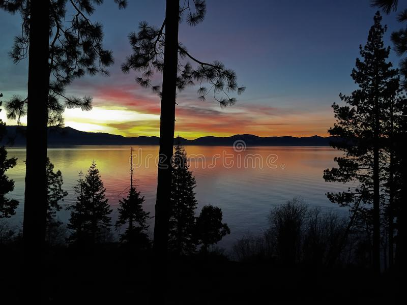 Sunset on Lake Tahoe. A beautiful sunset is filmed on a quiet evening at the American Lake Tahoe stock photo
