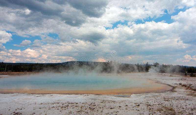 Sunset Lake under cumulus clouds in Black Sand Basin in Yellowstone National Park in Wyoming USA stock images