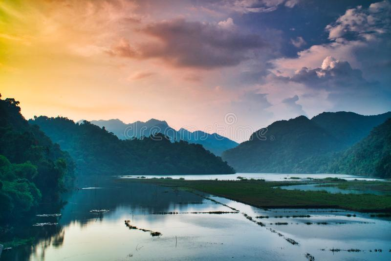 Sunset over lake in vietnam. Sunset  lake in vietnam. sunset  lake. sunset, sky, colors, mirror, mountains, vietnam, ricefield, clouds royalty free stock photography