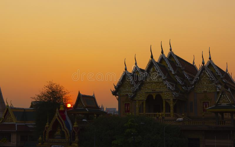Sunset at Laksi temple. Beautiful sunset and orange sky at Laksi temple, Bangkok, Thailand stock photo