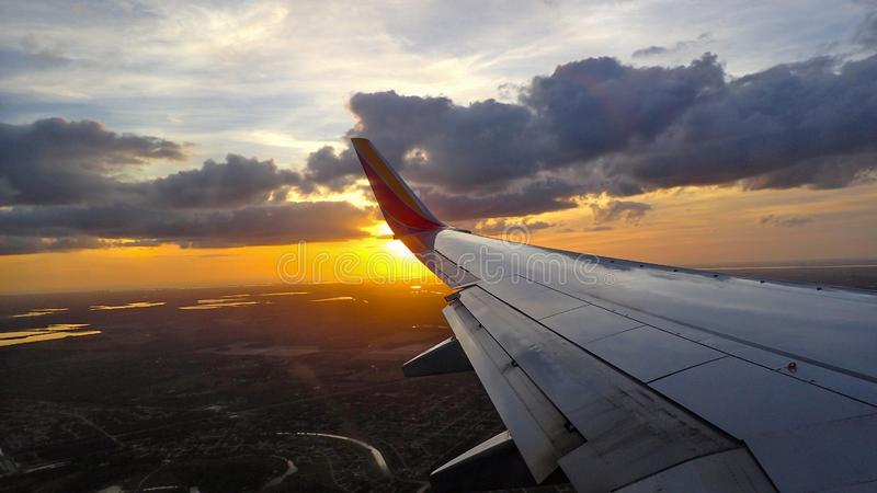 Sunset upon landing in an airplane royalty free stock photos