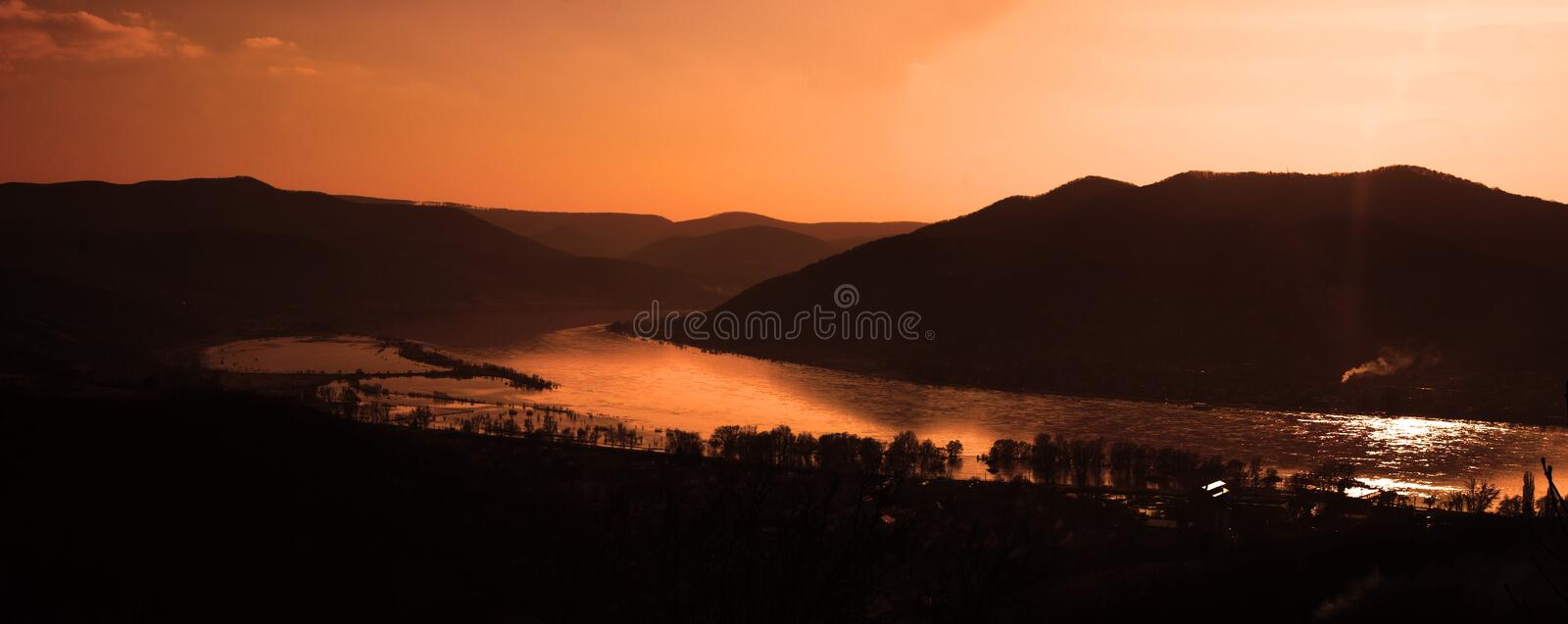 Sunset Landscape 2. This is a sunset landscape with river in the valley. The IRL location is the bend of Danube in Hungary during a the most higher flood in the royalty free stock images