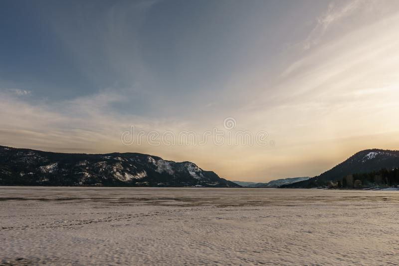 Sunset landscape of frozen Little Shuswap Lake British Columbia Canada royalty free stock photography