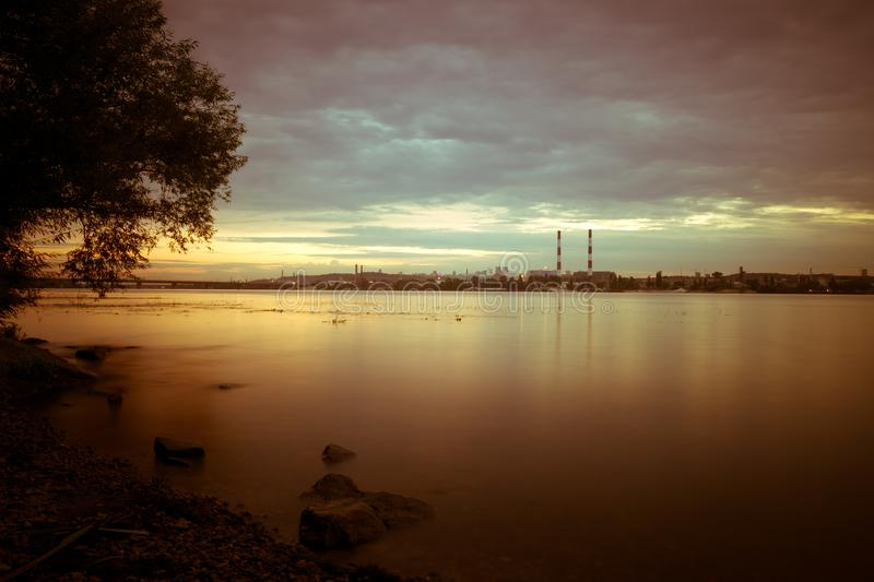 Sunset landscape over Dnipro river against Kyiv cityscape royalty free stock images