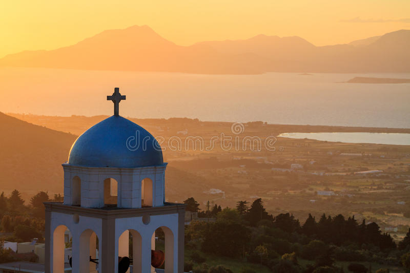 Sunset landscape. Sunset view with church belfry from Asfendiou village in Kos island Greece royalty free stock image