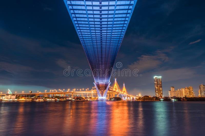 Sunset landscape view from under highway bridge. Transportation, architect civil engineering, or construction industry concept.  stock photo
