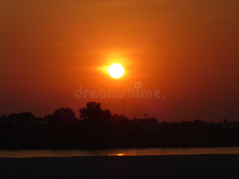 Sunset in Laos stock photo