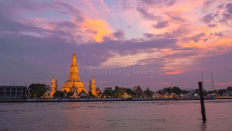 sunset at large illuminated temple Wat Arun ratchawararam stock image