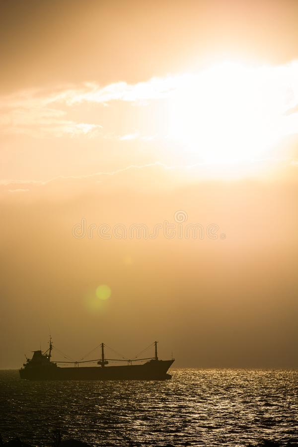 Sunset with lens flare and shadow of boat in Red Sea, Gulf of Aqaba royalty free stock image