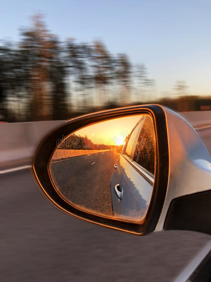 Free Sunset Light In A Rear View Car Mirror. Car On A Way To The Sea. Sunset Scene Reflection In The Mirror Of Car. Car Detailing Royalty Free Stock Photography - 116234977