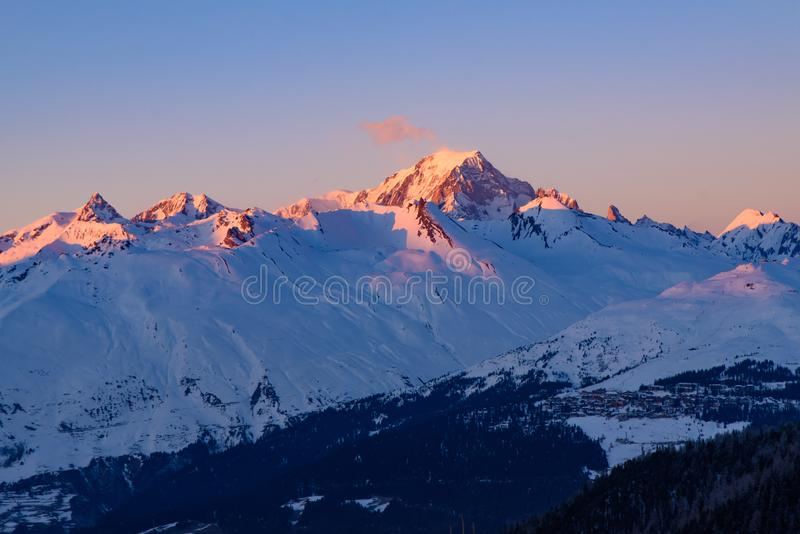 Sunset light on Mont Blanc in Savoie, France, the highest mountain in Europe west. Sunset light on Mont Blanc in Savoie, France, the highest mountain in the Alps royalty free stock photo