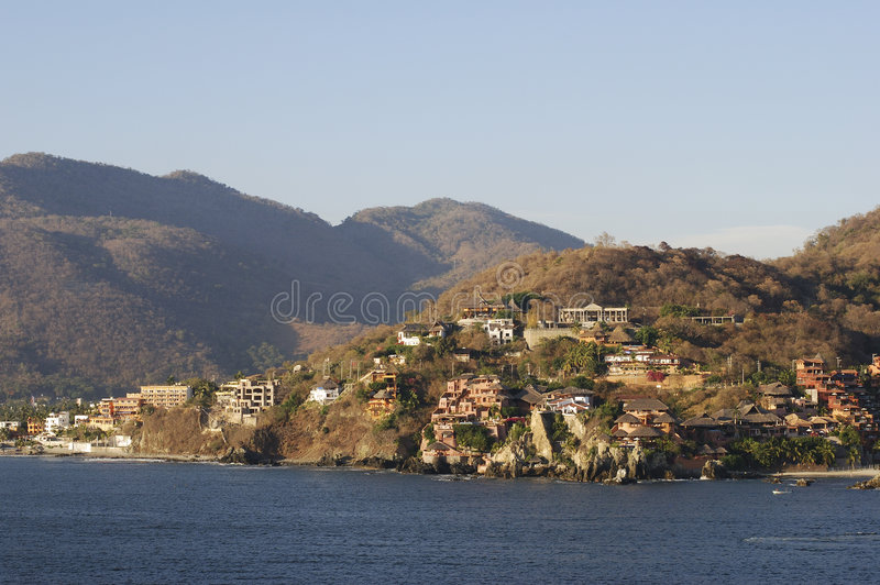 Sunset Light Over Zihuatanejo. Warm sunset light over mountains and many hotels in a resort town Zihuatanejo, Mexico stock image