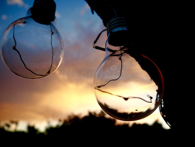 Sunset through the Lightbulbs stock photography