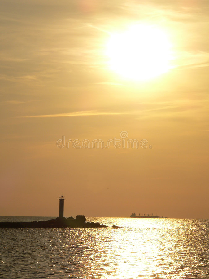 Sunset lighthouse stock photos