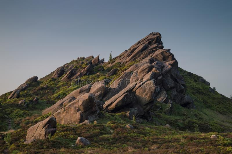 Sunset lights the heather and rocks at Ramshaw Rocks in the Peak District National Park. stock image