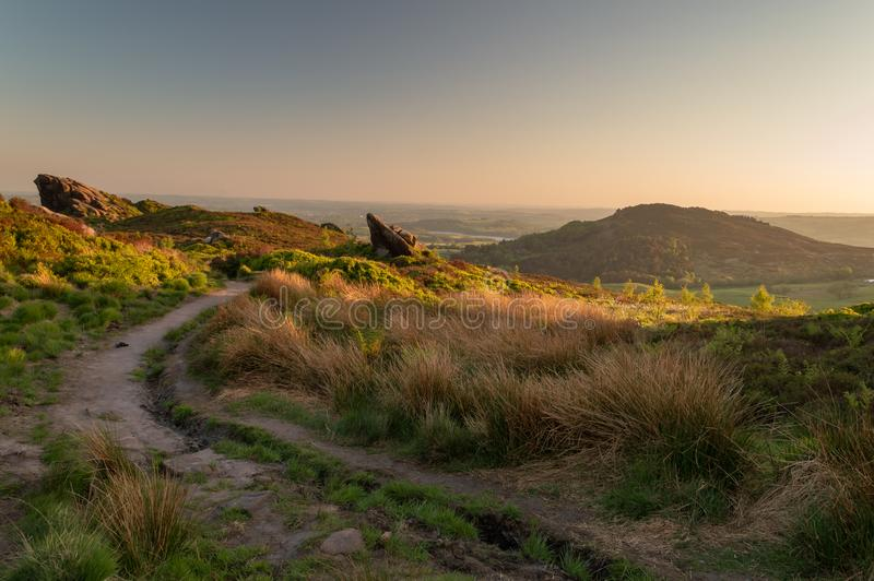 Sunset lights the heather and rocks at Ramshaw Rocks, near the Roaches in the Peak District National Park. stock images