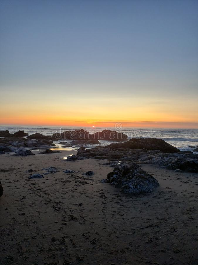 Sunset lincoln city, oregon. Sunset low tide 15th street lincoln city stock image