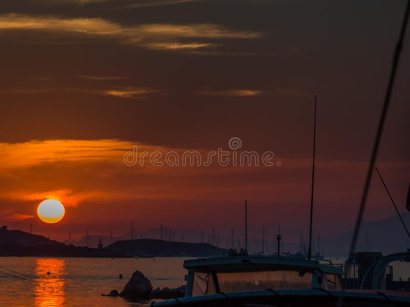 Sunset in a little port in French Riviera. Cote d`Azur French Riviera is situated in the southern eastern part of the mediterranean coast of France and it is royalty free stock photo